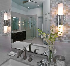 This bathroom was designed for a young, professional couple, expecting  their first child.  She had a more modern style and wanted a luxurious  retreat with a new tub and a spa-like ambience.  Her husband wanted a  slightly larger shower, a wider door to the closet and . . .  To make his wife happy.  Smart man, huh? ;-)