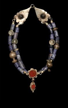 Pre-Columbian sodalite from Peru with 19th c. silver amulets Persia and silver Turkman beads.