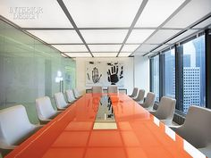 Seagram's Martini: EnTrust Capital's Headquarters Shakes Up A Midtown Landmark | Antonio Citterio chairs surround a custom back-painted glass tabletop in the boardroom, which also features a Jenny Holzer oil on linen. #office