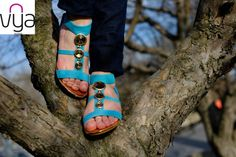 Heel measures approximately 2.5 inches. VYA's tropical turquoise sandals will refresh every outfit. With a wedge heel and on-trend single sole they're a comfortable way to add stature. Available at VYA Madrid's store.
