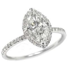 Marquise cut diamond ring haloed with a 1/2 carat of diamonds around with a slim band *sigh* dreaming away :)