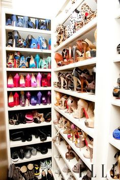 this is EXACTLY how i want to redo my closet. racks on racks on racks.