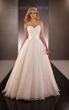 Take a look at this royal Organza designer ball gown wedding dress from Martina Liana featuring a fitted sweetheart bodice and full skirt embellished with Lacey floral accents.