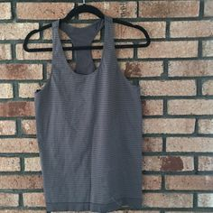 Under Armour Tank in Gray Excellent condition. Great for working out. Fitted. No size label but is a size large. Minor stain see photo. Can be removed. No rips. Prices are not firm unless stated. Please make your best offer!! Not my size I do not model.  ✅REASONABLE OFFERS  📦SHIPS SAME OR NEXT DAY 🚫NO TRADES/ HOLDS 🚫NO PAYPAL  🚭SMOKE FREE HOME 🎁 PERSONALIZED BUNDLES 🤔 UNSURE? PLEASE ASK QUESTIONS 👀 CANT FIND IT? SOLD ELSEWHERE Under Armour Tops Tank Tops