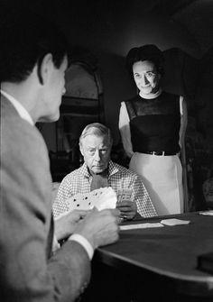 The Duke of Windsor playing poker. Wallis looks on.