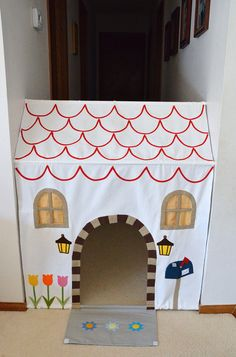 "Playhouse in a hallway!  I'm going to use this idea and adapt it to create a tent in front of the library for Summer Camp Read!  Just using long tension poles, sewing pockets on the back of the green fabric for the rods, then opening the front of the ""tent"" and rolling it back to enter the library. Cool!  I also bought astro turf for grass..."