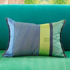 Orsoglio Cushion in forest hues working beautifully with deep emerald