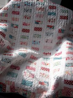 Cute jellyroll quilt. I like the two sided border only.