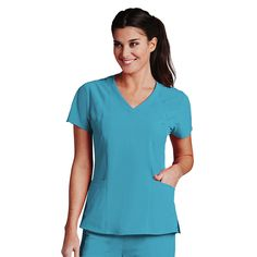 You're sure to love the athletic feel of this Barco One™ Women's V-Neck Perforated Shoulder Solid Scrub Top. The perforated panels enhance moisture-wicking qualities for a style that stays cool and dry all day long. #scrubs #bluescrubs #scrubstyle