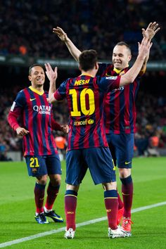 Adriano Correia (L), Lionel Messi (C) and Andres Iniesta (R) of FC Barcelona celebrate after Lionel Messi scored his team's second goal during the La Liga match between FC Barcelona and RC Celta de Vigo at Camp Nou on March 2014 in Barcelona, Catalonia. Fc Barcelona, Barcelona Players, Barcelona Futbol Club, Real Madrid Players, Barcelona Catalonia, Adriano Correia, Messi 2015, Messi Photos, Camp Nou