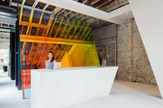 Humming Puppy Yoga Studio by Karen Abernethy Architects  angled screen that is lined with a dichroic filter