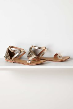 Flickerfly Sandals, Gold | Anthropologie.eu On our radar this summer: shimmered, embroidered, and embellished sandals that let us cool our heels but still wear dresses. Consider that just the beginning of a long list of outfitting options for this silvered pair from Jasper & Jeera.