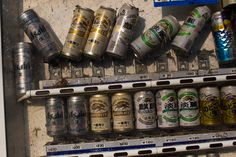 In this July 13, 2011 photo, cans of beer lie dislodged inside a flood-damaged vending machine in an abandoned neighborhood in Naraha, Japan inside the nuclear exclusion zone. (AP Photographer David Guttenfelder on assignment for National Geographic)