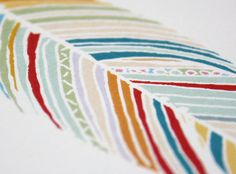 Applique patterned fabrics in 'stripes' to make this abstract feather? I think it will look great Jan!