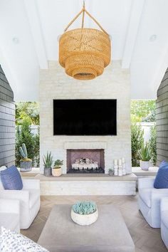 Woven chandelier outside covered patio vaulted ceiling covered patio herringbone cement floors light color stone fireplace Outdoor fireplace Woven chandelier outside covered patio vaulted ceiling covered patio herringbone cement floors light colo Home Design, Patio Design, Studio Design, Interior Design, Niche Design, Bar Interior, Design Ideas, Modern Design, Design Inspiration