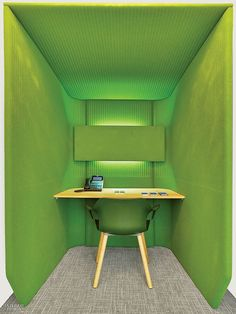 Cheeky Touches Enliven Educators 4 Excellence Office by Kati Curtis | Wool felt lines a phone booth.