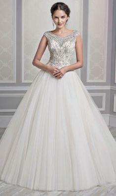 Wedding dress idea; Featured Dress: Kenneth Winston