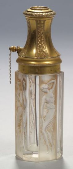Octagonal clear glass cologne bottle with alternating panels of cut glass relief of standing 4 female figures by René Lalique, and with ormolu top and accents of leaves marked Le Parisien, Breveté S.G.D.G. France early 20th Cent