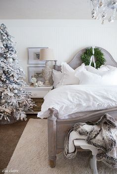 A cozy Christmas bedroom is extra magical with plush white bedding, french country touches, fresh boxwood wreaths and its own Christmas Tree decorated in mercury glass, snowflakes, ivory ribbon and frosted pinecones.