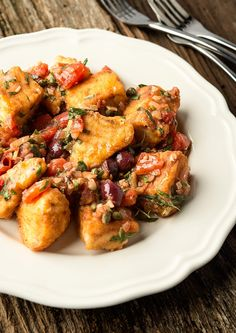Pesce alla puttanesca, fish with a zesty Italian sauce that can be made almost entirely with pantry staples. I use halibut, but any firm, white fish will work. Recipe from Hunter Angler Gardner Cook.