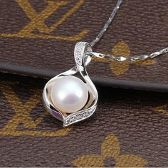 The pearl necklace large pearls pearls pearl necklaces and the freshwater pearl pendant necklacepearl wedding pendantbridesmaid pearl pendantwhite pearl pendant pearl necklace pendantpearls pendants aloadofball Gallery