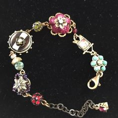 Handmade crafted vintage looking bracelet Bought at craft show vintage looking bracelet with different colors and shapes. Adjustable sizing on the end. With clasp. Never worn. Jewelry Jewelry Bracelets