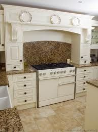 White Kitchen Countertops With Brown Cabinets brown granite in a beautiful white kitchen in a model home in