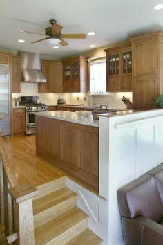 Sunken living room ascending into glossy open kitchen. :D