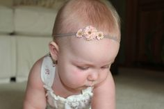 Delicate roses adorn a beige stretchy headband for a look that s perfect  for your bitty baby 53c184ede11