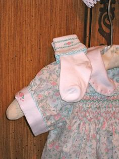 Smocked and piped matching socks.