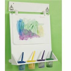 Space Saver Wall Mounted Paint Easel by Kaplan Early Learning Company. $139.95. Attach to a classroom wall or on the side of a storage cabinet. Great for ages 3 and up. Built-in tray to hold paint cups. Save floor space. Save floor space with our new wall mounted easel. Attach to a classroom wall or on the side of a storage cabinet. Angled surface to allow paint from dripping or running. Built-in tray to hold paint cups (sold separately). Paint clips are not included.