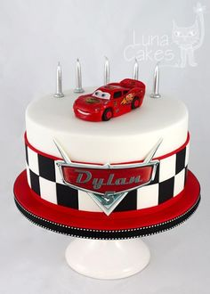 for bottom part of cake with race track around bottom./ toy story on top with clouds. #cars #cars #cake