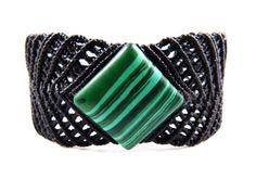 The centre of the extravagant, ornamental knot pattern is adorned by a beautiful, natural malachite gemstone with an amazing, organic green & black structure - a perfect gift for men.