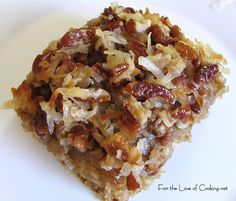 Oatmeal Cake with Coconut Pecan Frosting ~ mix oatmeal with boiling water, add to white sugar, brown sugar, flour, salt, baking soda, egg, shortening; bake until done; spread cake with topping (butter, brown sugar, shredded coconut, chopped nuts, milk, vanilla); broil until coconut is brown; cool, slice, serve and enjoy!