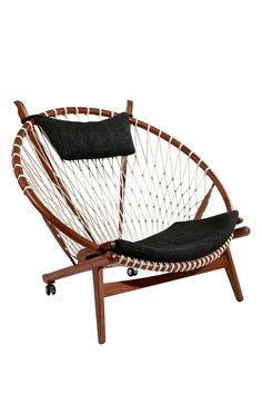 """Hoop Chair in black by Mid Century Classics From Control Brand $4815 - $2079  @HauteLook. - Seat and back are woven halyard - Color: black - 15"""" seat height - 38"""" H x 44.63"""" W x 37"""" D - Solid wood, leather - Dry wipe clean **Cannot be shipped to Canada***"""