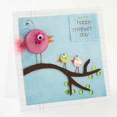buttons with googly eyes, patterned paper, and feathers. chipboard branch