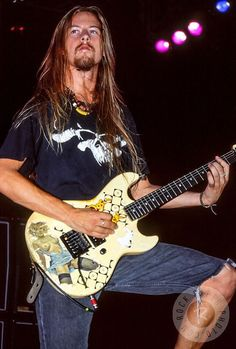 """I snapped this one of Jerry Cantrell of Alice in Chains back in 1991 when they opened for Van Halen. This was taken of Jerry when he began playing the riff of ""We Die Young"" Alice in Chains was probably my favorite of all of the Seattle grunge bands. Always in incredibly intense performance! -Paul Jendrasiak"