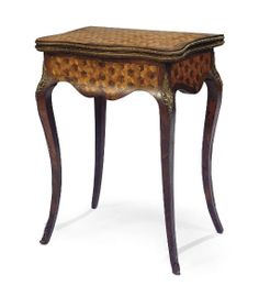 A NAPOLEON III MARQUETRY GAMES TABLE