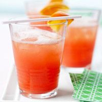 The June Bug. 3 cups ginger ale, 4 tblsp grenadine, 4 tblsp orange juice, 3 scoops orange sherbet plus white rum.  YUM!!!