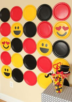 Make a fun space meant for big smiles  with a DIY photobooth  background made of paper plates! With a little prep work, this photobooth backdrop goes up quickly