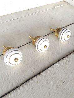 White and Gold Decor, Gold Accents, Home Decor, Vintage Style Decor, Gold and White Knobs, Accents, Decorative Knobs, Dresser Drawer Knobs by honeywoodhome on Etsy https://www.etsy.com/listing/264544762/white-and-gold-decor-gold-accents-home