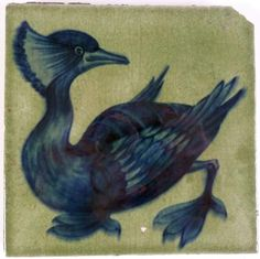 WILLIAM DE MORGAN, SANDS HILL POTTERY, FULHAM, POTTERY TILE DECORATED IN BLUE with a crested grebe #ukauctioneers