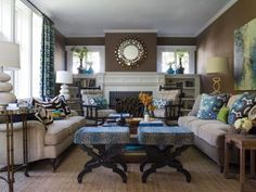 Ann Lowengart shows just how to use a neutral like greige to highlight bolder colors. In this living room, she mixed accents of blue, green and chocolate brown to add interest against the backdrop of the more neutral wall. Colorful accents are easily swapped in and out as color tastes change.