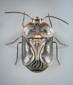 Harlequin Bug - by Elizabeth Goluch | sterling silver, l8k gold, moonstone, fresh water pearls, glass beads