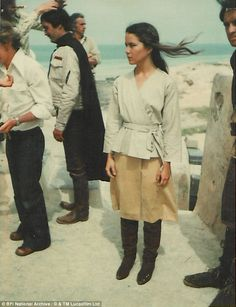 The images show stars relaxing between scenes. Pictured here is Koo Stark, who played Camie - though her scenes were not used in the final film release