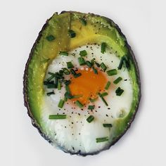 Paleo-Powered Breakfast: Eggs Baked in Avocado: For a one-two punch of omega-3s in your breakfast, try baking eggs in an avocado.