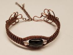 Hey, I found this really awesome Etsy listing at https://www.etsy.com/listing/513457169/black-obsidian-woven-copper-bracelet