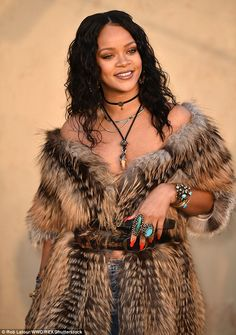Effortlessly chic Rih in fur, bracelets and rings with turquoise