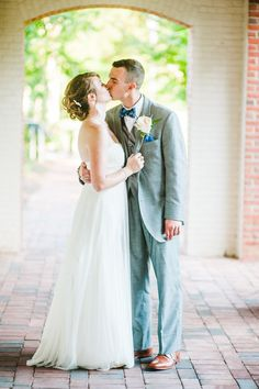 Simple wedding gown | Lydia & Ross' personalized, St. Mary's College Maryland wedding | Images: Porter Watkins Photography | #marylandwedding #simplewedding
