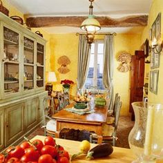 distressed green and yellow kitchen | French chairs and Hutch painted in a classic distressed green finish.